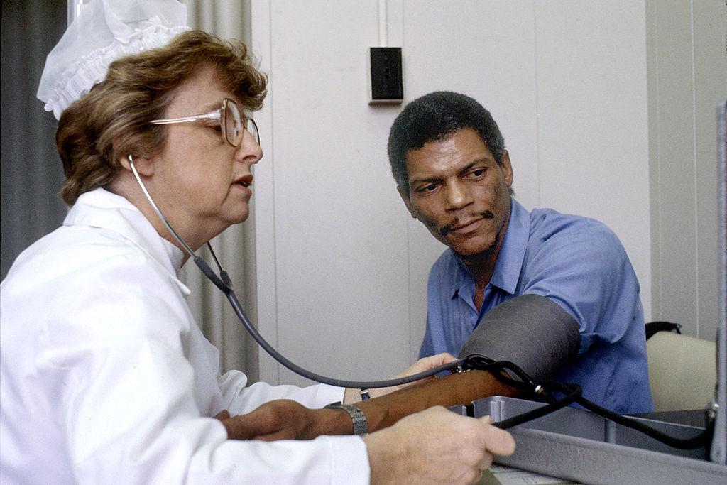 1024px-Nurse_checks_blood_pressure
